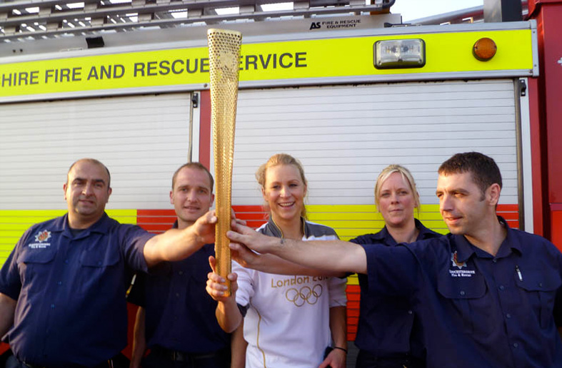 Suzanne shares an Olympic moment with her firefighter mates